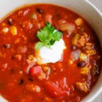 healthy turkey chili in bowl with sour cream