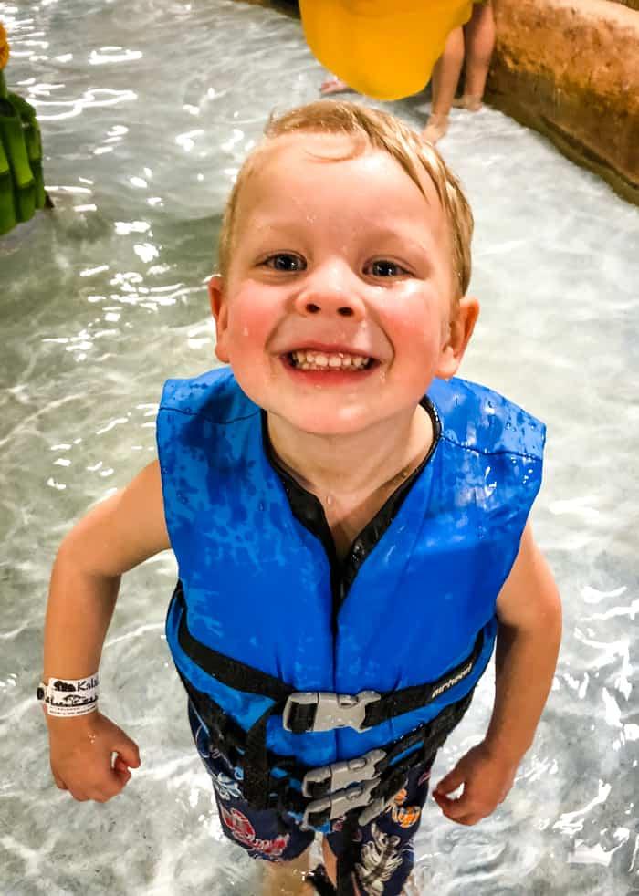 kid wat waterpark smiling