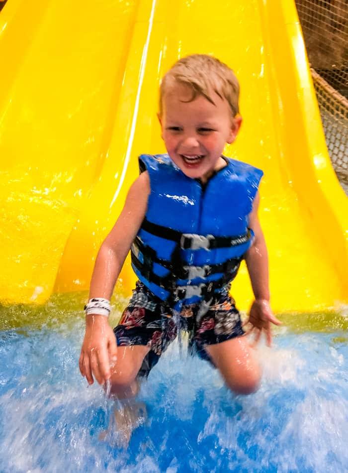 kid on slide at waterpark