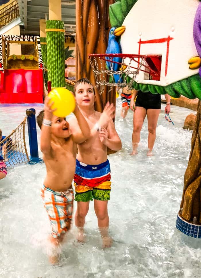 kids playing basketball at waterpark