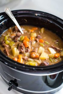 slow cooker beef stew with spoon