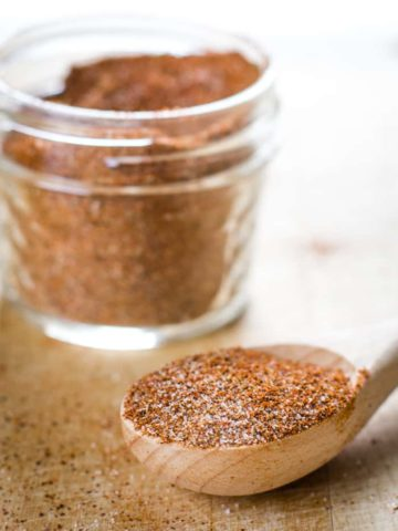 homemade chili seasoning in jar with tablespoon
