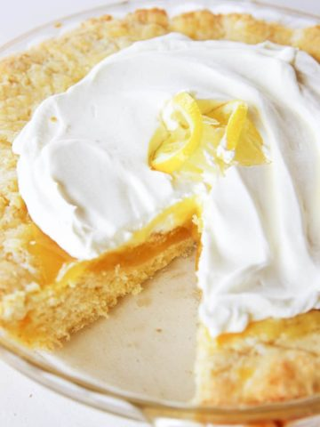 lemon pie in baking dish with lemon on top