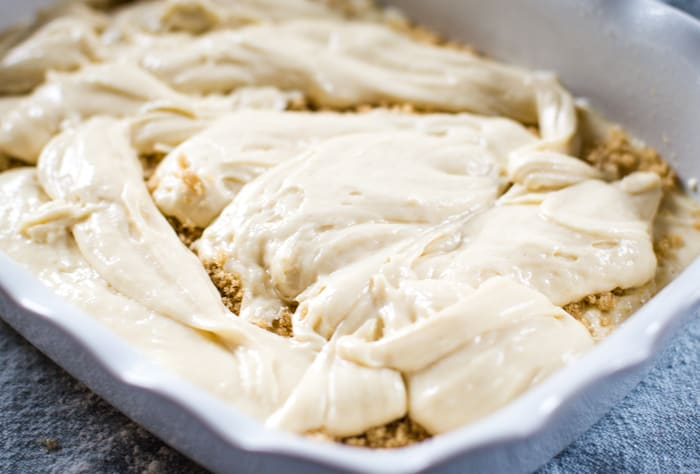 sour cream coffee cake batter and topping in baking pan