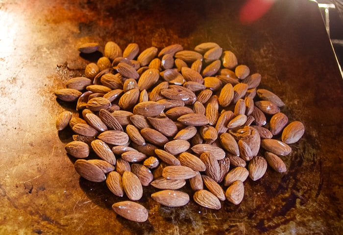 toasted almonds on pan in oven