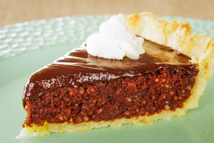 slice of chocolate coconut pie with whipped cream on top