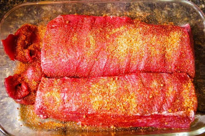 seasonings on backstrap venison to marinate