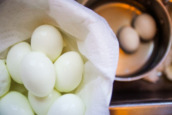 peeled hard boiled eggs in bowl