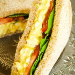 egg salad sandwich with lettuce and tomato