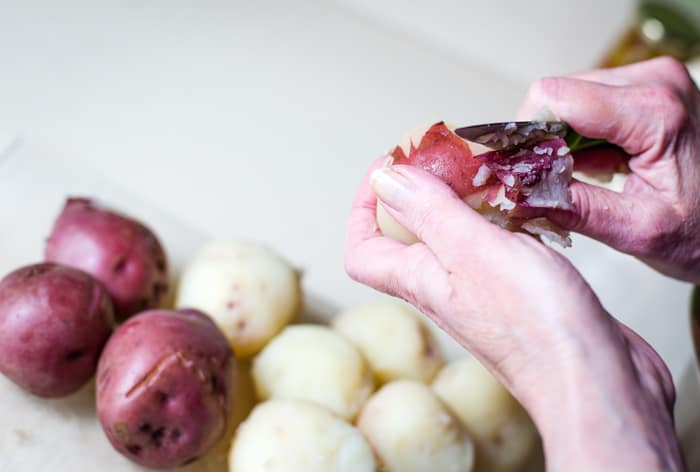 peeling red potato