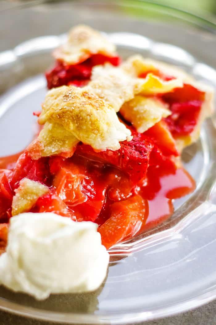 slice of strawberry rhubarb pie on plate