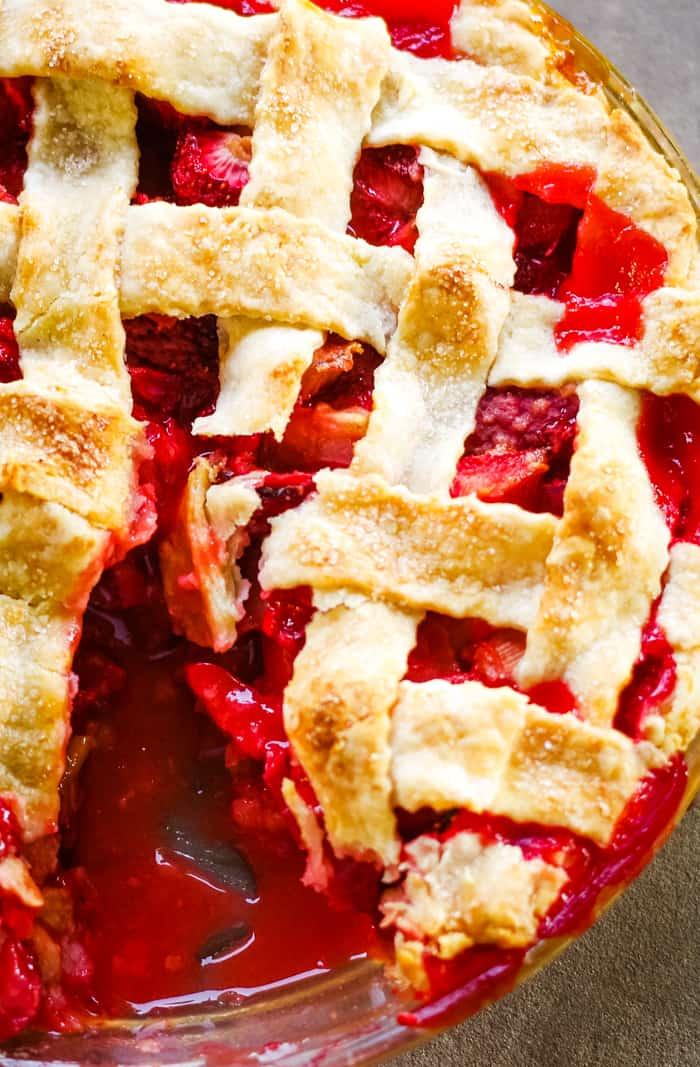 strawberry rhubarb pie with slice