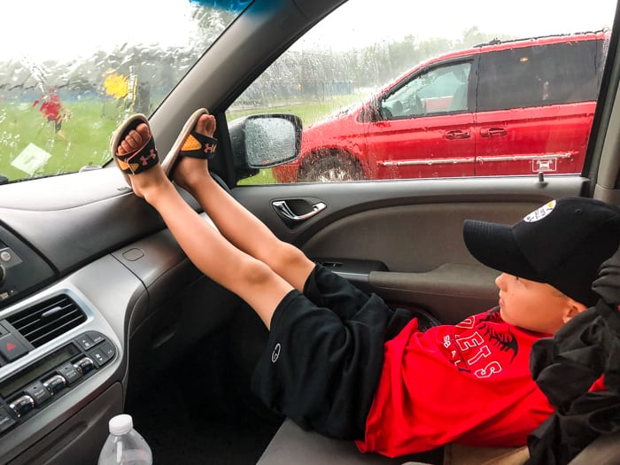 boy in front seat parked car