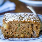 zucchini cake on plate with fork