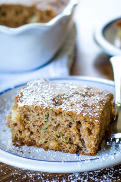 zucchini cake slice on plate with fork
