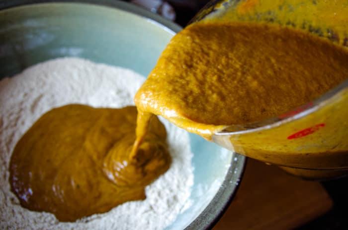 combining wet and dry ingredients for pumpkin bread