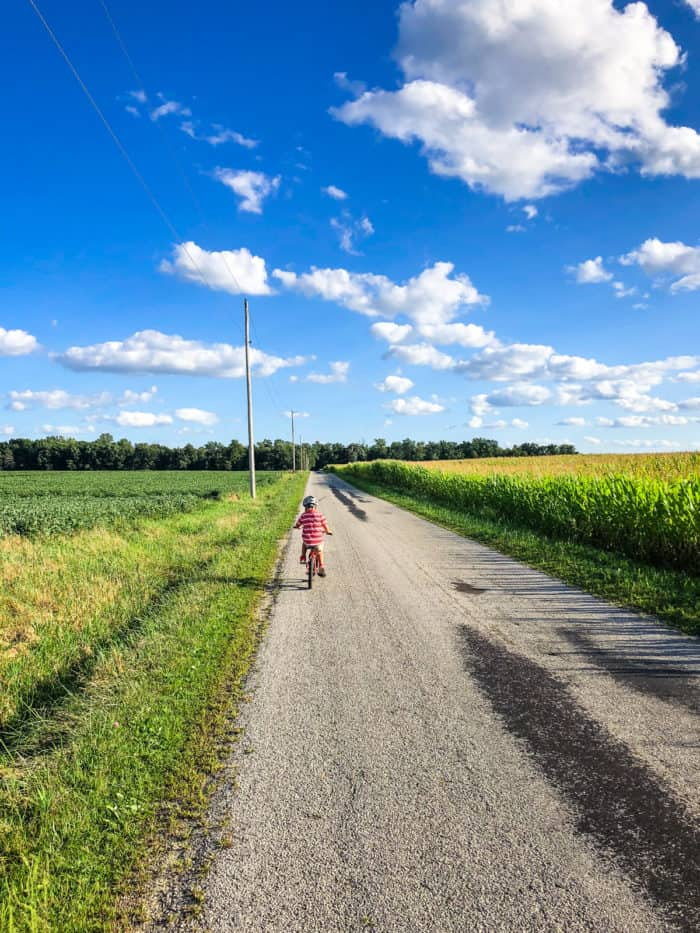 boy on bike on country road