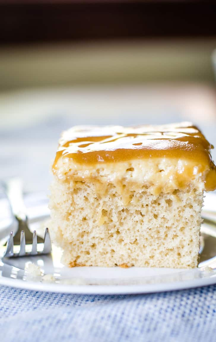 caramel cake with cream cheese frosting and layer of caramel sauce