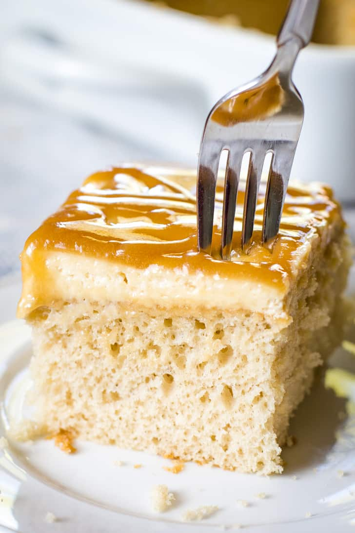 caramel cake with fork on white plate