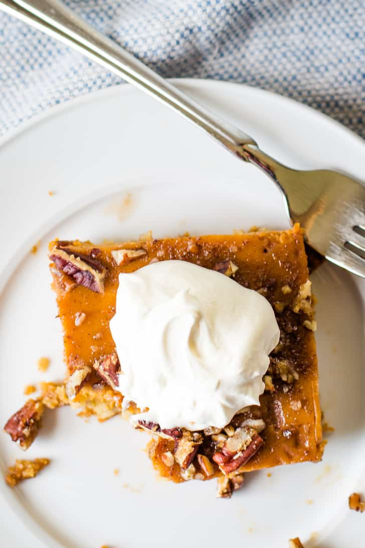 pumpkin pie bars with whipped cream on plate
