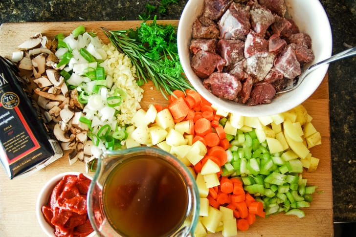 slow cooker venison stew ingredients on cutting board