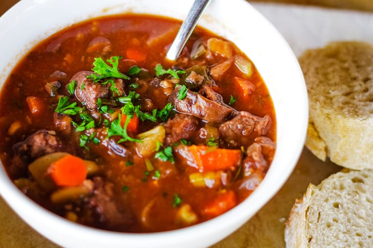 venison stew in bowl with bread