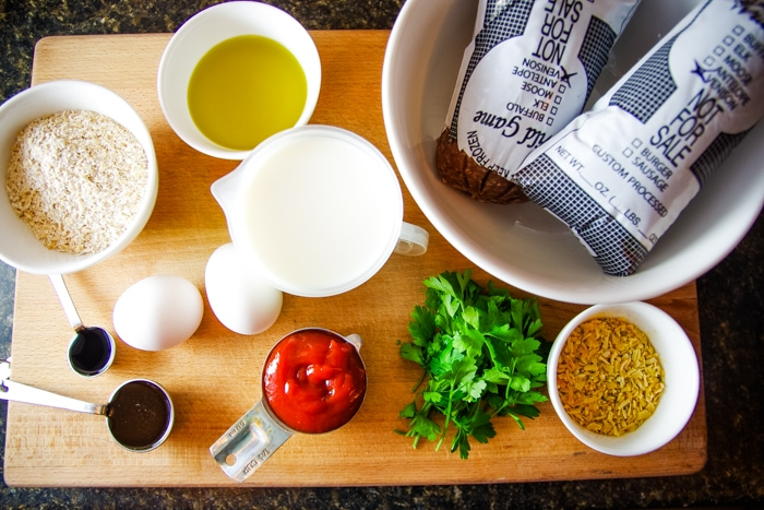 venison meatloaf ingredients on cutting board