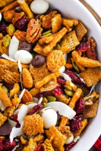 caramel chex mix in white bowl