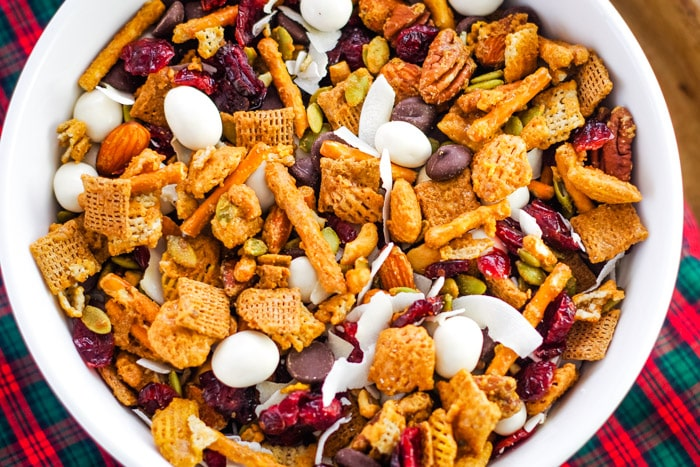 caramel chex mix in bowl with christmas cloth