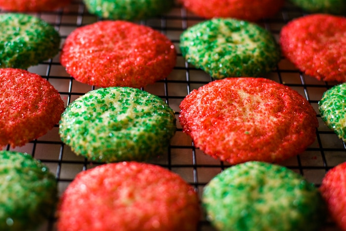 red and green sugar cookies on cooling rack