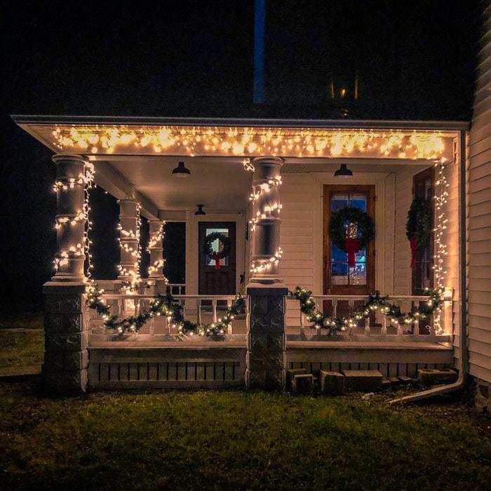white lights on farmhouse porch
