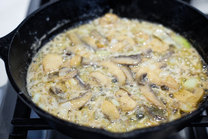 onions and mushrooms in pan