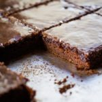 texas brownies with slice on sheet pan
