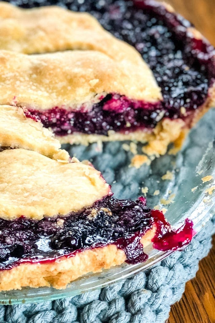 slice out of blueberry pie with thick pie filling