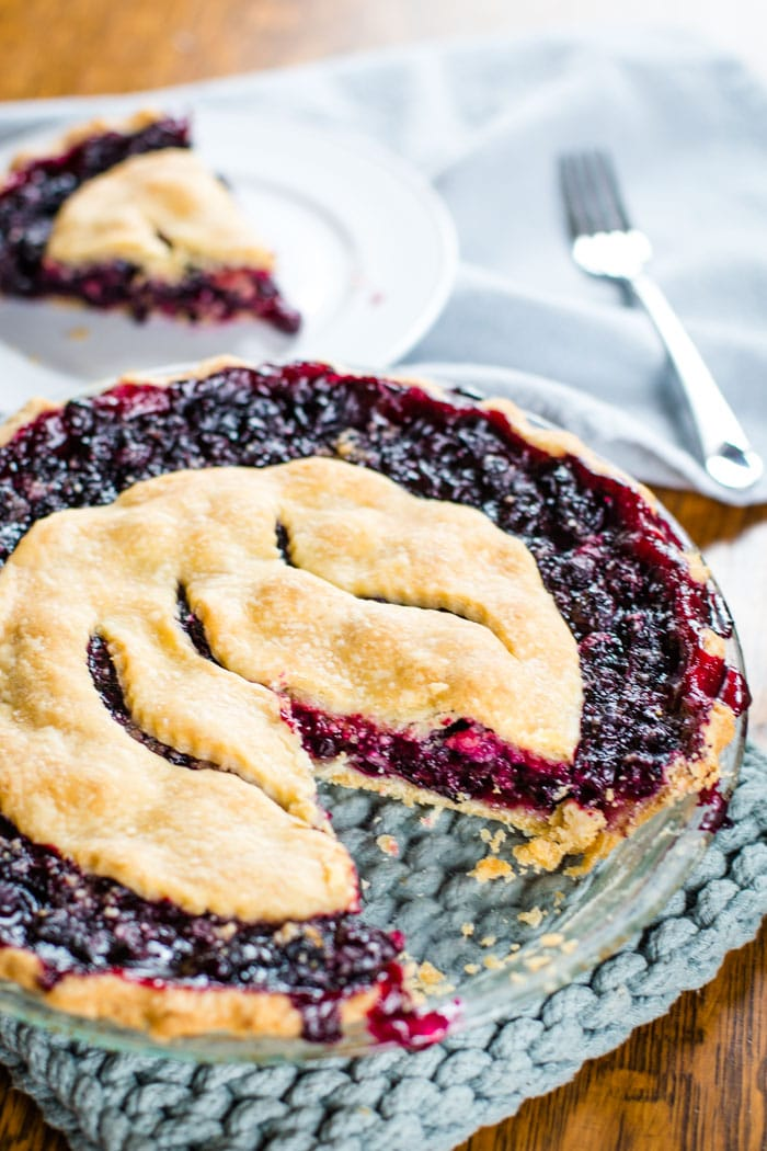 sliced blueberry pie with thick pie filling