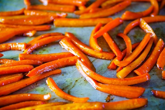 roasted glazed carrots on baking pan