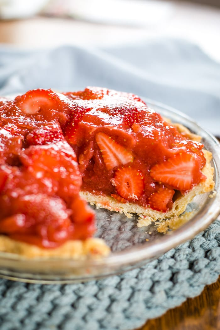 strawberry pie in pie plate with slice