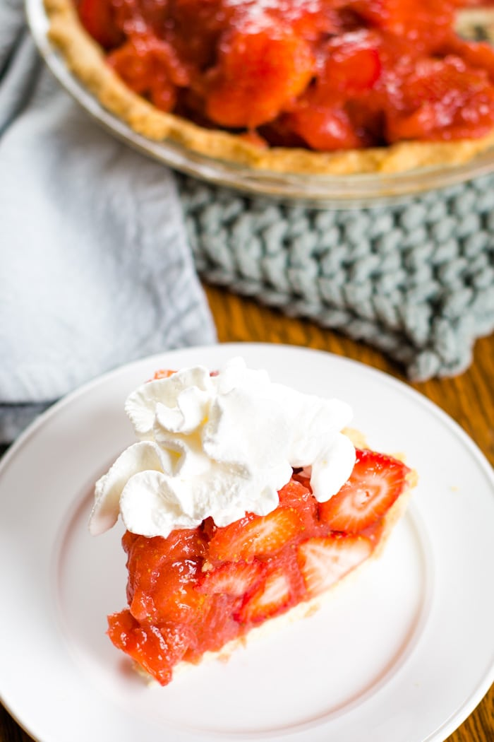 strawberry pie slice with whipped cream