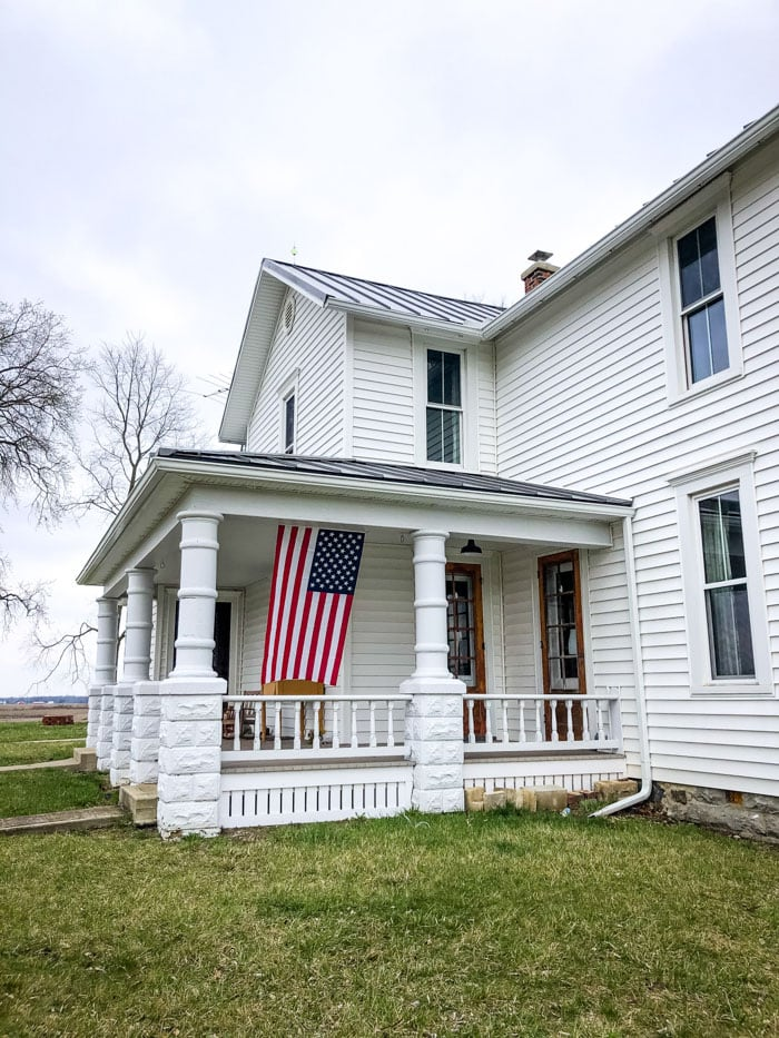flag on front of porch