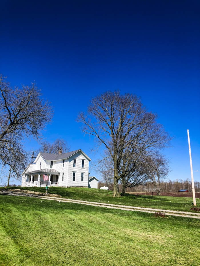 mowed lawn with farmhouse