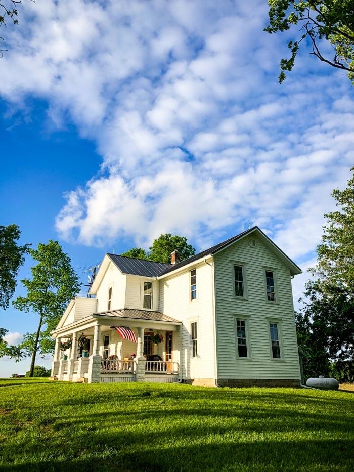 white farmhouse with blue sky