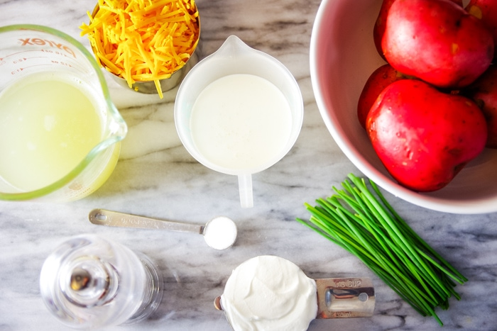 ingredients for scalloped potatoes on cutting board