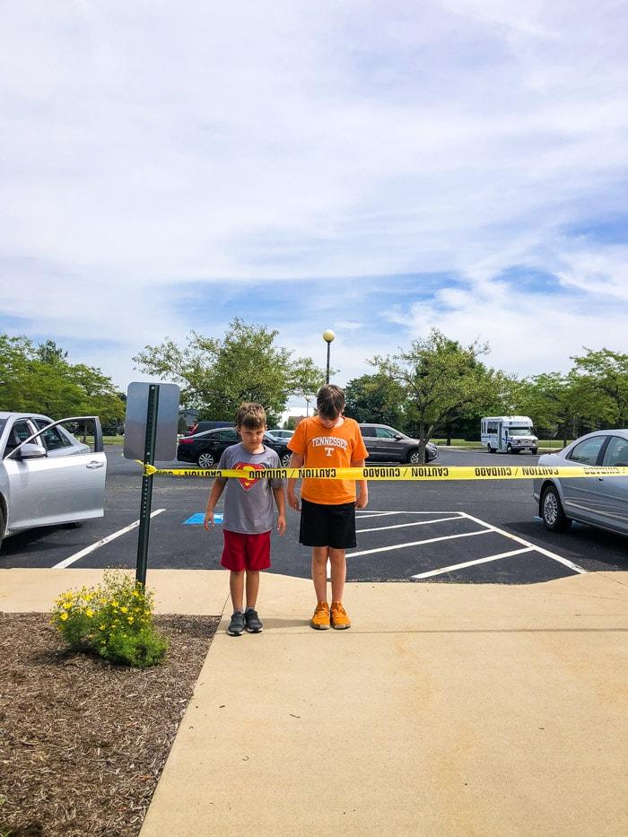 kids behind caution tape