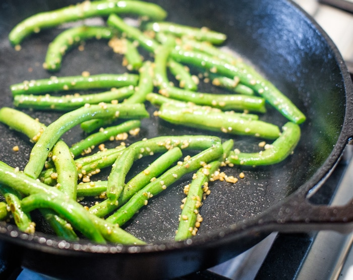 green beans sauteed in skillet