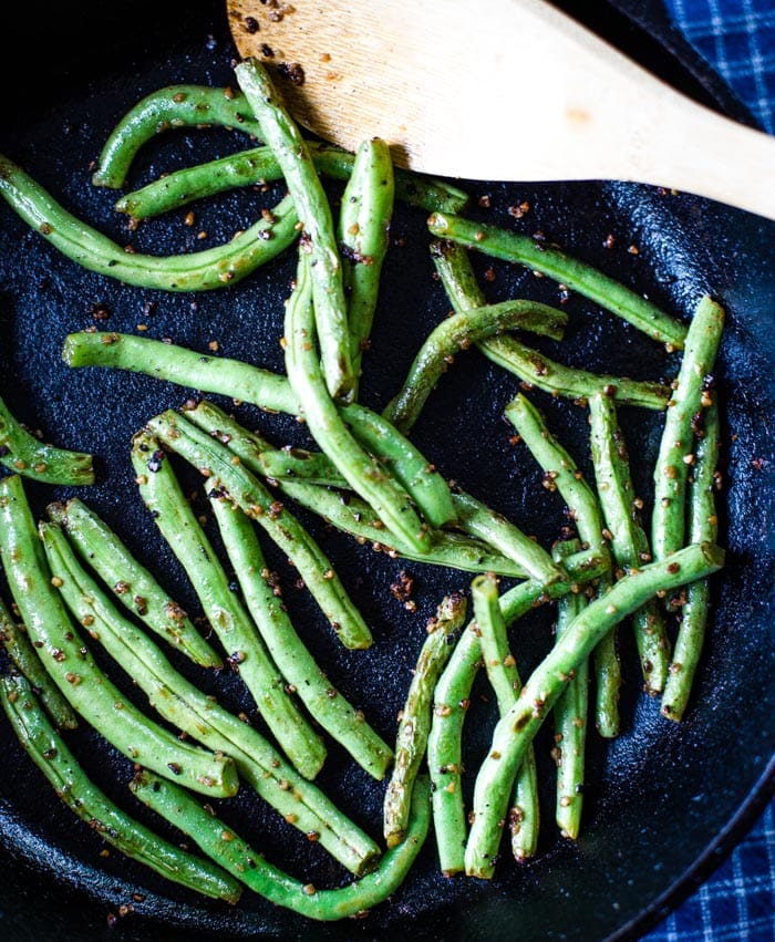 fresh green beans sauteed with wooden spoon