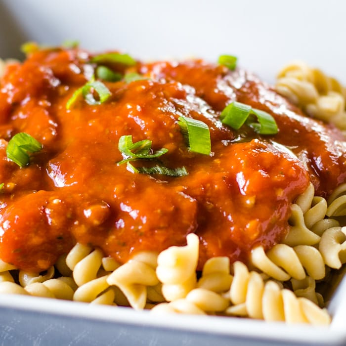 thick tomato sauce from fresh tomatoes on noodles