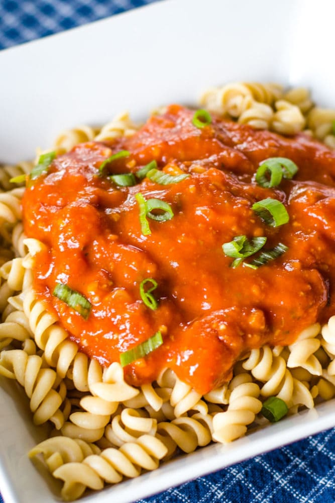 spaghetti sauce on noodles in bowl