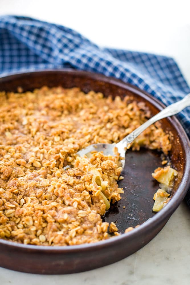 apple crisp with spoon on table