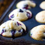 blueberry muffins in muffin pan baked