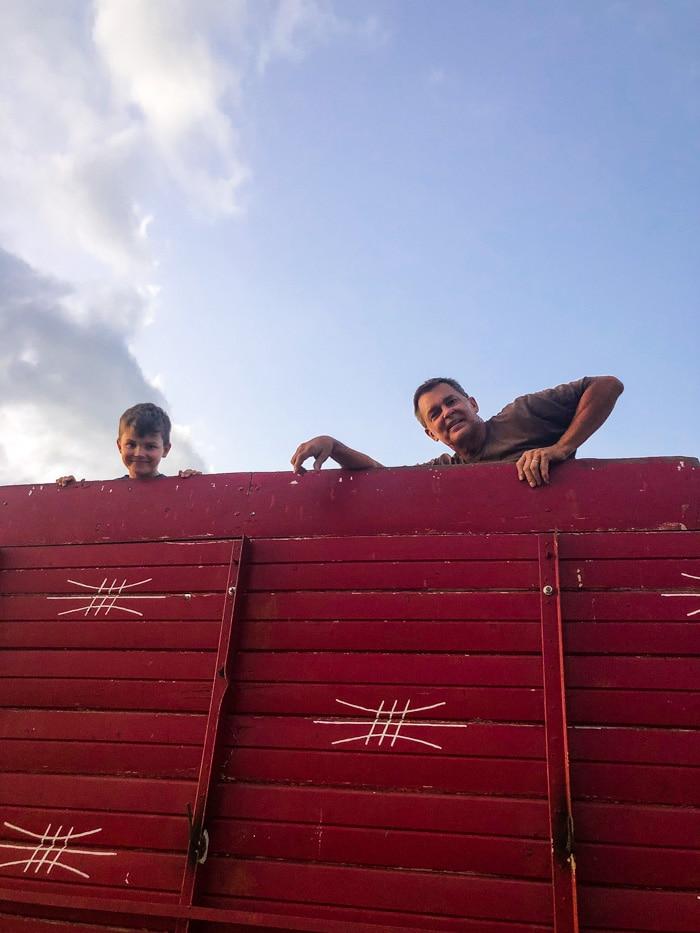 grandpa and boy in grain truck